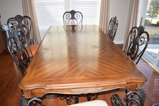 A dull brown table that gets a makeover using furniture stencils from Cutting Edge Stencils. http://www.cuttingedgestencils.com/rabat-furniture-fabric-stencil.html