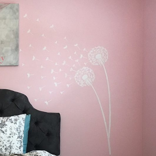 A DIY pink and white stenciled accent wall using popular flower stencils, the Dandelion Stencil, from Cutting Edge Stencils. http://www.cuttingedgestencils.com/dandelion-stencil.html