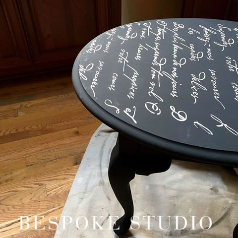 A black and white stenciled side table using the French Poem Craft Stencil from Cutting Edge Stencils. http://www.cuttingedgestencils.com/french-poem-diy-craft-stencil-design.html