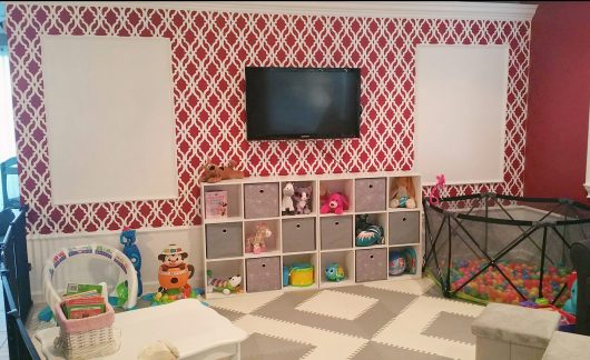 A DIY stenciled red and white playroom accent wall using the Tamara Trellis Allover Stencil from Cutting Edge Stencils. http://www.cuttingedgestencils.com/tamara-trellis-allover-wall-stencils.html