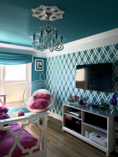 A DIY turquoise and white stenicled accent wall using the Tamara Trellis Allover Stencils from Cutting Edge Stencils. http://www.cuttingedgestencils.com/tamara-trellis-allover-wall-stencils.html