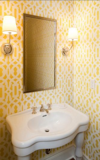 A yellow and white DIY stenciled powder room using the Trellis Allover Stencil from Cutting Edge Stencils. http://www.cuttingedgestencils.com/allover-stencil.html