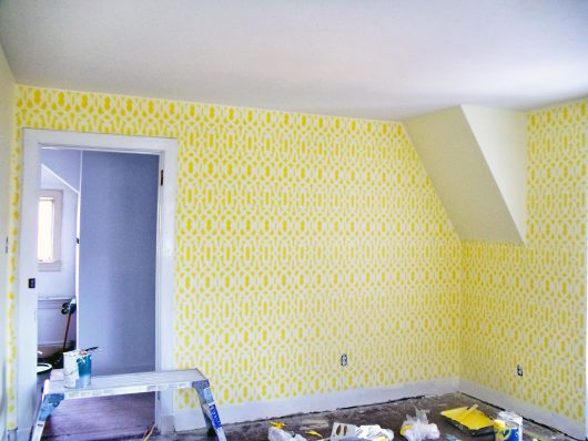 A yellow and white DIY stenciled room mimicking wallpaper using the Trellis Allover Stencil from Cutting Edge Stencils. http://www.cuttingedgestencils.com/allover-stencil.html